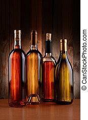 Wine Bottles Against Wood Background