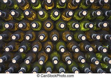 wine cellar - wine bottles arranged in a darkness wine...