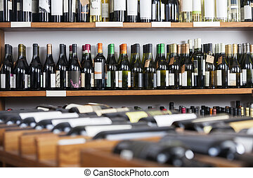 Wine Bottles Displayed On Shelves - Wine bottles displayed...