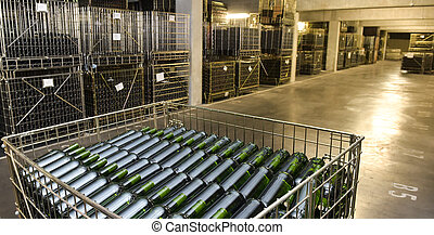 Wine bottles in industrial cellar