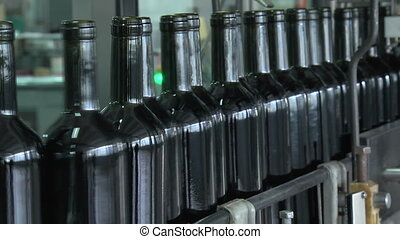 Wine Bottles Moving Along The Conveyor Line