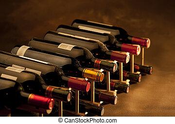 Wine bottles on rack - Red wine bottles stacked in rack on...