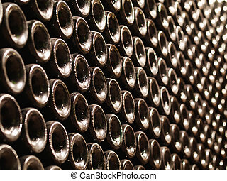 Wine bottles - Row of Bordeaux wine bottles stacked in a...