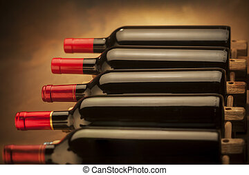 Wine bottles - wine bottles stacked on wooden racks shot...