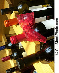 wine bottles with red ribbon