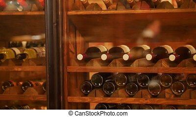 Wine Cabinet with collection wines in the restaurant. close...