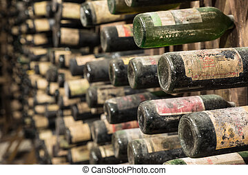 Wine Cellar - An old wine cellar with old bottles full of...