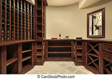 Wine cellar in luxury home with wood racks