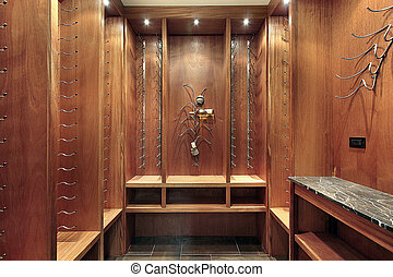 Wine cellar with wood cabinetry