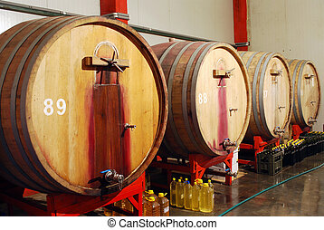 wine cellar with wooden barrels