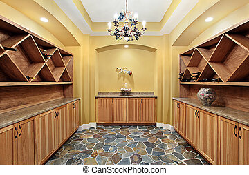 Wine cellar with yellow walls - Wine cellar in luxury home...