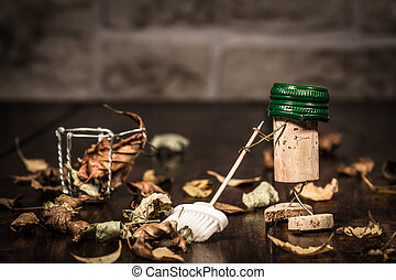 Wine cork figures, Concept sweeping foliage with a broom -...