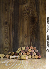 wine cork on a background of boards and corkscrew