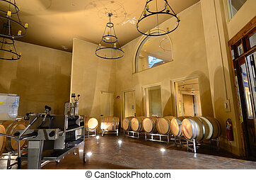 Wine Distillery - Vats in a cellar wine distillery.