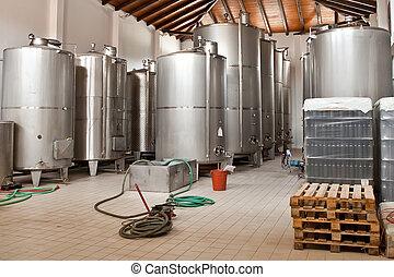 Wine Fermenting in huge vats in a wine cellar. Shoot in ...