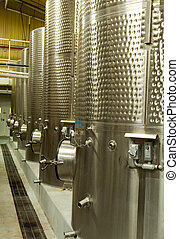 Stainless steel fermenting tanks in a California winery