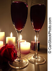 wine glases an a rose - romantic scene with candles, wine...