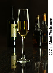 Wine glass and Bottle on a black mirror background