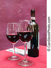 Wine glass and Bottle on a red background