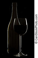 Wine glass and bottle on black background rim lighting