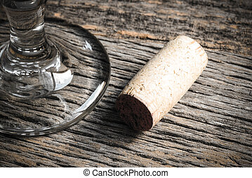Wine Glass and Cork on Rustic Wooden Background