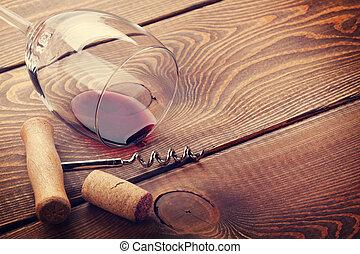 Wine glass, cork and corkscrew