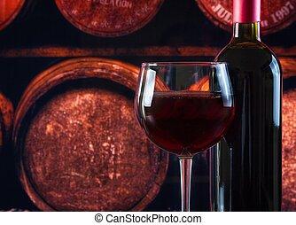 wine glass near bottle in old wine cellar background