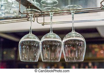 Wine glass on rack - Close up wine glass on rack above...