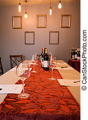 Wine, Glasses, and Tasting Sheets on Long Table