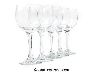 Wine glasses arranged on a table, isolated over white