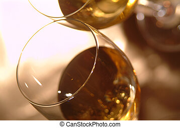 wine glasses filled with white wine
