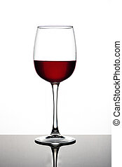 Wine glasses of different shapes with multi-colored drinks on a white background with reflection