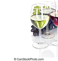 Wine - Glasses of white, red and rose wine and grapes over...