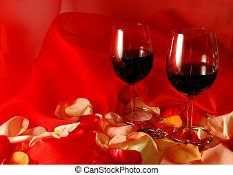 valentines day - wine glasses on flower petals for...