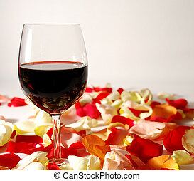 wine glasses on flower petals for valentines day