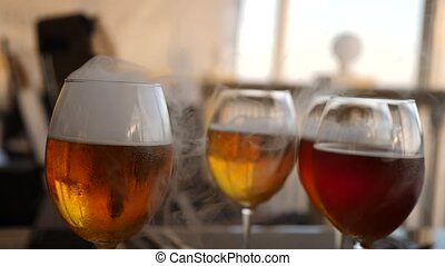 Wine glasses with alcohol close-up. Slow motion. Beer tasting