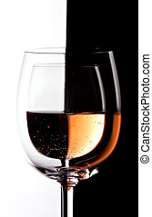 Wine glasses with contrast in color and reflections