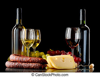 Wine, grapes, cheese and sausage on black background