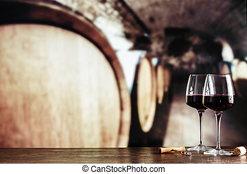wine in barrels and in glasses