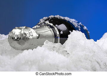 Wine in bottle on snow and ice - ready for serving