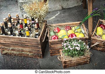Wine in bottles, apples, pears.