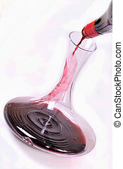 wine in decanter - red wine being poured into a decanter