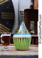 Wine in old bottles. - Wine in old bottles on a barrel.