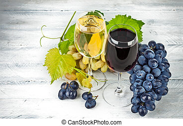 Wine in wineglass with grapes