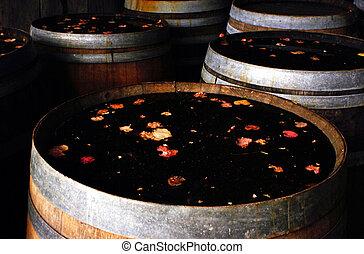 Old oak wine barrels in vineyard.