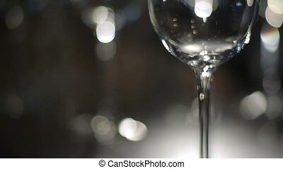 Wine is poured into a glass goblet - Red wine is poured into...