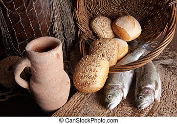 Wine jug with bread and fish - Vintage still life of an old ...