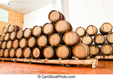 Wine keg barrels stacked keep cool.