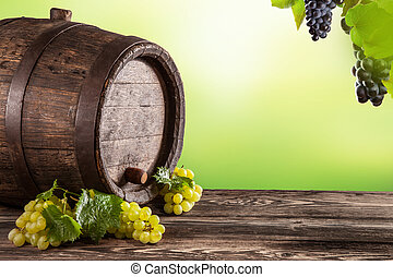 Wine keg on wood with blur green background - Dteail of wine...