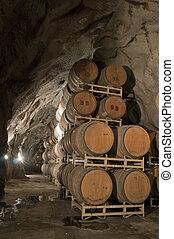 Wine Kegs Underground - Wine keg barrels stacked underground...